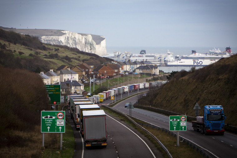 Image: Freight trucks line up on the M20 motorway near Dover port in December 2020