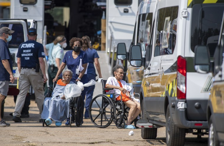 Image: Paramedics evacuate nursing home residents from a mass shelter on Sept. 2, 2021 in Independence, La., where they had been taken ahead of hurricane Ida.