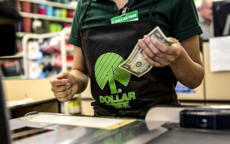 An employee works at a cash register at a Dollar Tree Inc. store in Chicago on March 3, 2020.