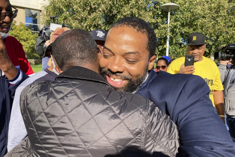 Juwan Deering gets a hug outside the courthouse in Pontiac, Mich., on Sept. 30, 2021, after murder charges against him were dropped in a fire that killed five children in suburban Detroit in 2000.