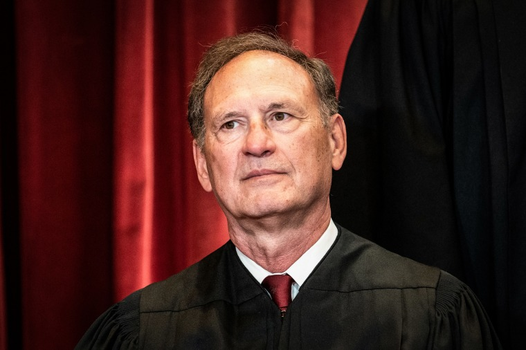 Associate Justice Samuel Alito sits during a group photo of the Justices at the Supreme Court on April 23, 2021.