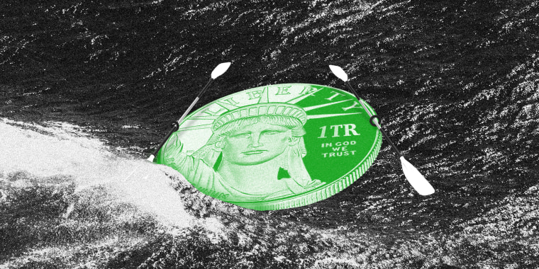 """Photo illustration: Waves crashing into a coin which has paddles on both sides. The coin reads,\""""Liberty\"""", \""""1TR\"""", and \""""In God We Trust\""""."""