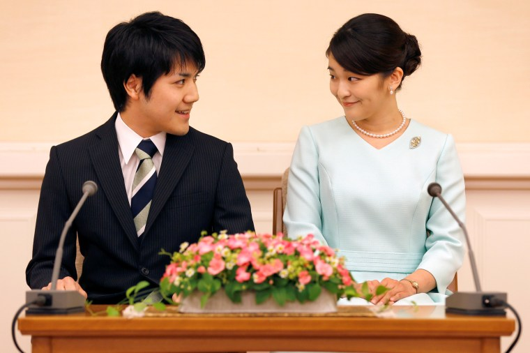 Image: FILE PHOTO: Princess Mako, the elder daughter of Prince Akishino and Princess Kiko, and her fiancee Kei Komuro, a university friend of Princess Mako, smile during a press conference to announce their engagement at Akasaka East Residence in Tokyo