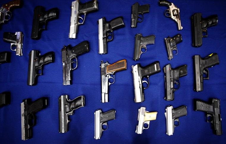 Image: Seized handguns in New York in 2013.