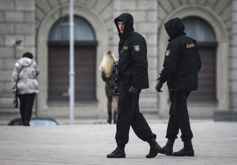 Armed police officers patrol Oktyabrskaya Square in Minsk, Belarus March 24, 2017.