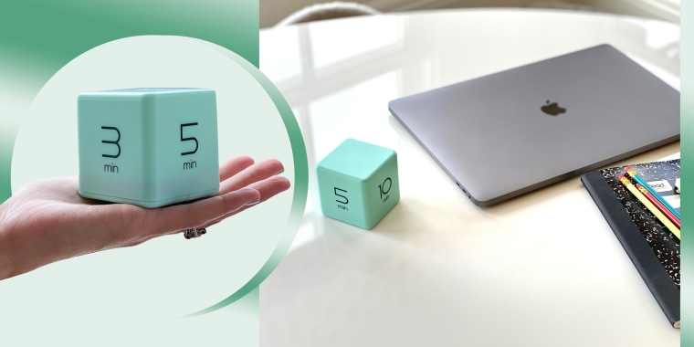 Writer Molly Fahner Calhoun shares her timer cube in her hand and next to her laptop