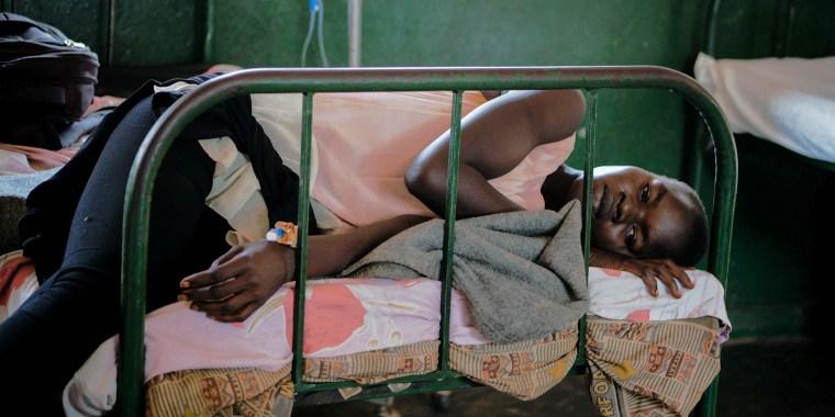 Image: TOPSHOT-HEALTH-VACCINES-MALARIA-UGANDA-KENYA-GHANA-MALAWI