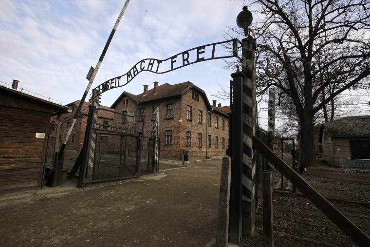 """German writing """"Work Sets You Free"""" on the gate of the Auschwitz Nazi death camp in Oswiecim, Poland."""