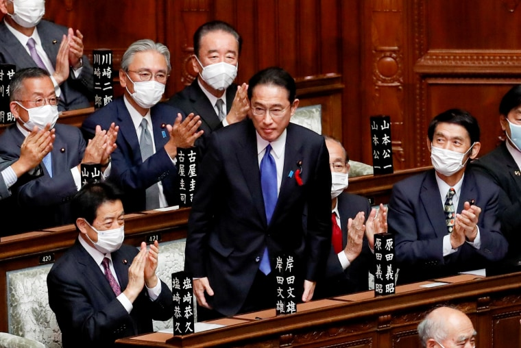 Image: Japan's newly-elected Prime Minister Fumio Kishida is applauded after being chosen as the new prime minister, at the Lower House of Parliament in Tokyo