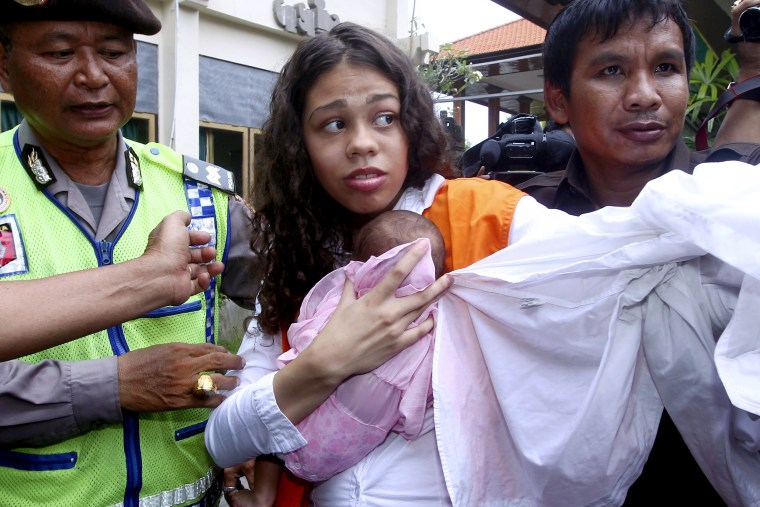 Heather Mack is escorted by police officers as she arrives in the courtroom for her sentencing hearing in Denpasar, Bali, Indonesia on April 21, 2015.