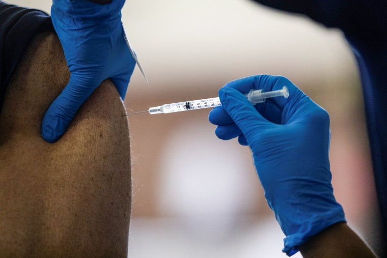 A patient receives a Pfizer-BioNTech Covid-19 vaccination booster in Southfield, Mich., on Sept. 29, 2021.