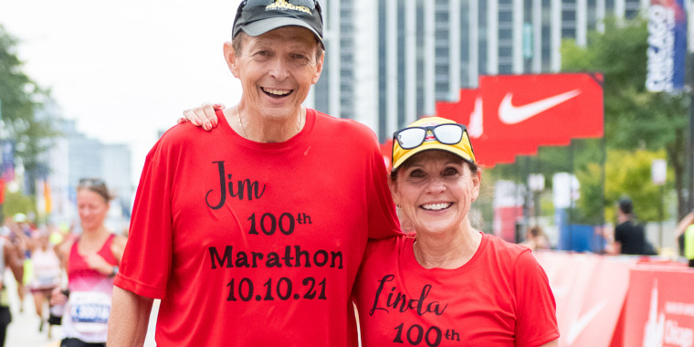 The Ballards are all smiles after completing their 100th race together.