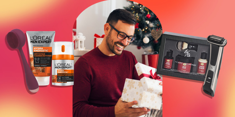 Smiling young man opening Christmas gift at home and some grooming products to buy from Amazon this holiday