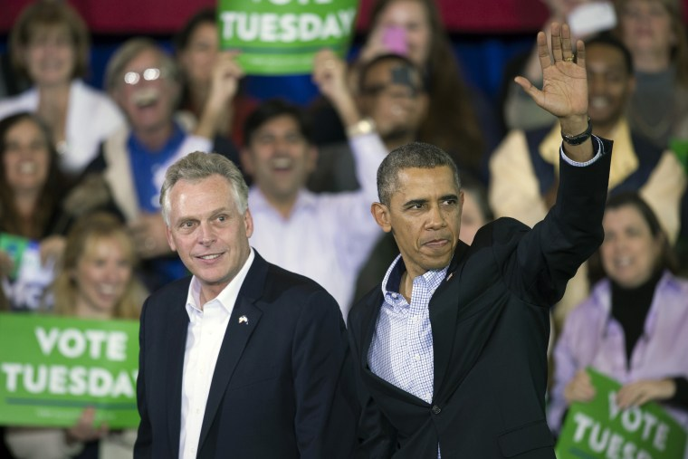 Then-President Barack Obama appears at a campaign rally with supporters for Virginia Democratic gubernatorial candidate Terry McAuliffe in Arlington, Va., on Nov. 3, 2013.