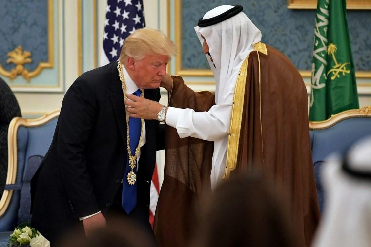 President Donald Trump receives the Order of Abdulaziz al-Saud medal from Saudi Arabia's King Salman in Riyadh on May 20, 2017.