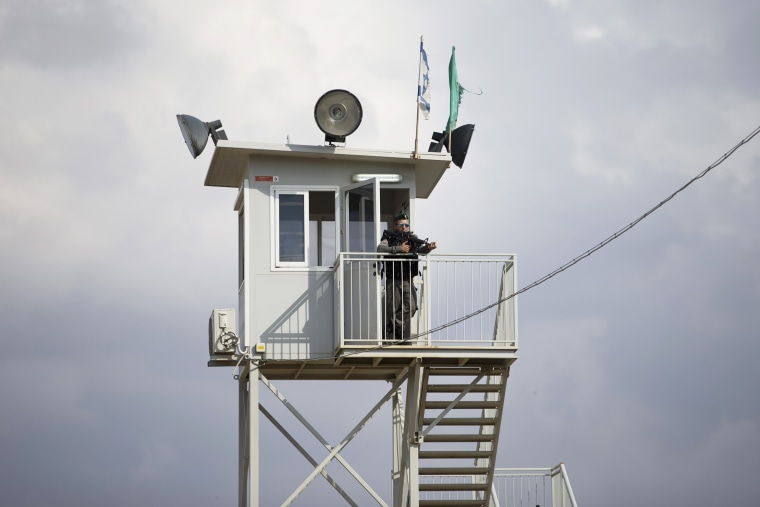 Image: An Israeli border police officer watches from a tower at a checkpoint near the West Bank town of Nablus, on Oct. 30, 2015.
