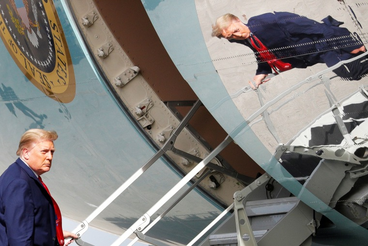 Image: President Trump is seen reflected while boarding Air Force One in West Palm Beach