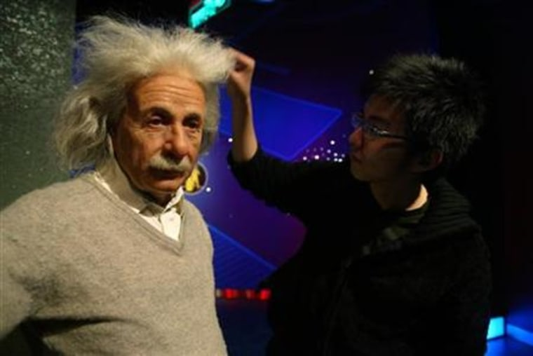 An artist adjusts the hair on a wax model of mathematician Albert Einstein at Madame Tussaud's Wax Museum in Shanghai.Germany has launched a plan to improve higher education in a bid to create a newgeneration of Einsteins.