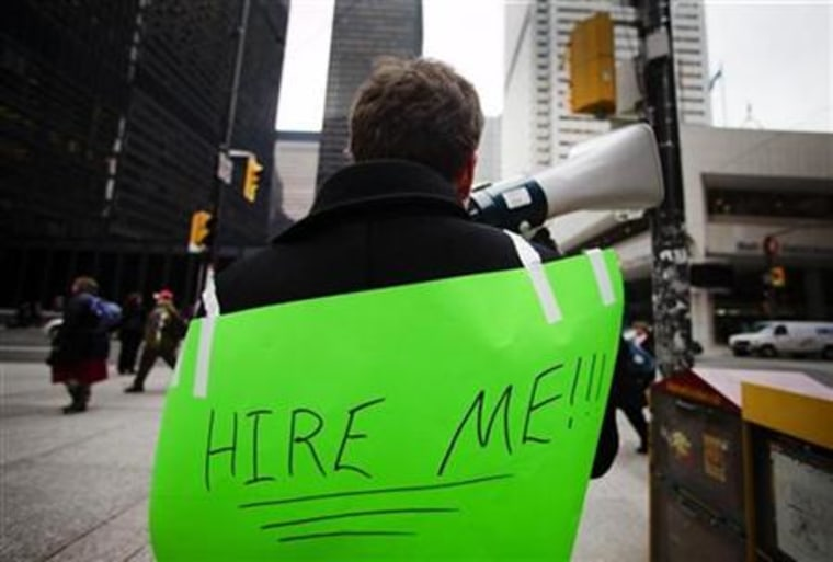 Lukas Stewart uses a megaphone to attract the attention of potential employers on Bay Street in the financial district in Toronto
