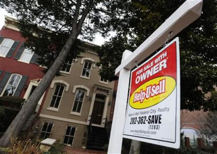 A sign marks a house for sale by the owner in the Capitol Hill neighborhood in Washington