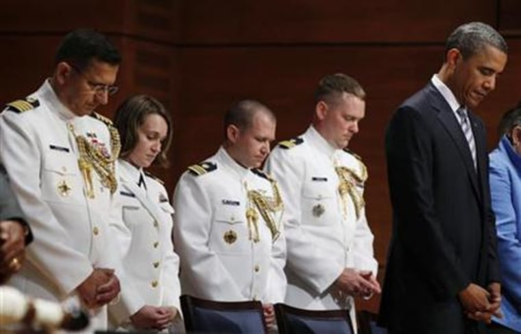 U.S. President Obama prays before the U.S. Coast Guard Academy commencement exercises in New London