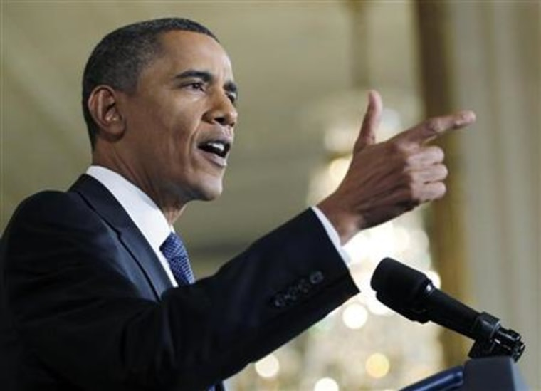 President Barack Obama gestures during a nationally televised news conference in the East Room of the White House in Washington