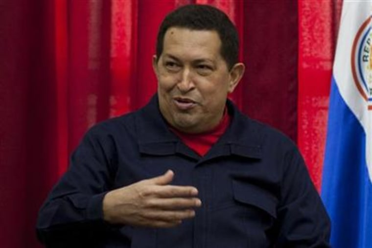Venezuela's President Hugo Chavez talks during a meeting at Miraflores Palace in Caracas