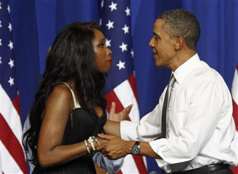President Barack Obama is greeted by singer Jennifer Hudson at a Democratic National Committee (DNC) event at the Aragon Entertainment Center in Chicago