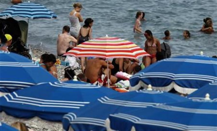 Holiday makers enjoy the beach in Nice, southeastern France, at the start of the summer holidays