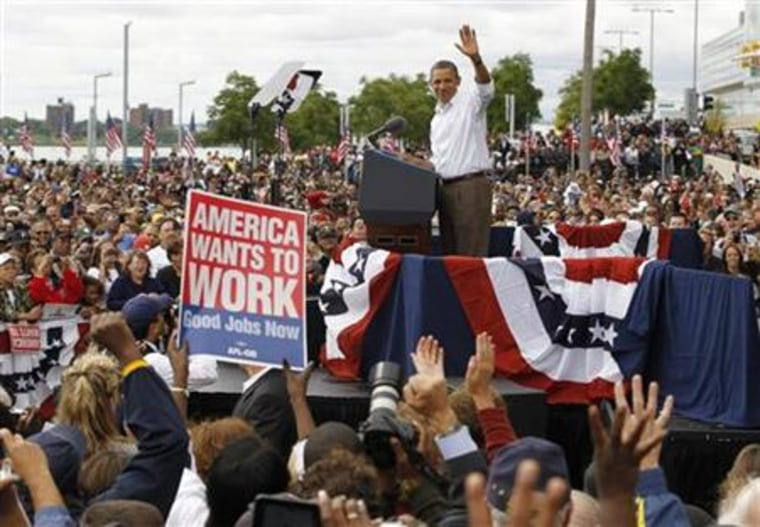 President Obama waves at a Labor Day event in Detroit