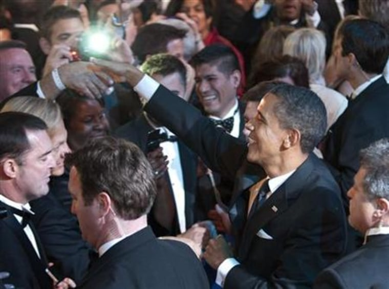 Obama greets attendees after delivering remarks at the Human Rights Campaign's annual dinner in Washington