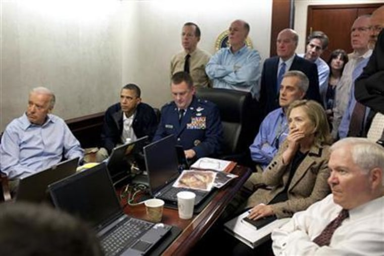 President Barack Obama (2nd L) and Vice President Joe Biden (L), along with members of the national security team, receive an update on the mission against Osama bin Laden in the Situation Room of the White House