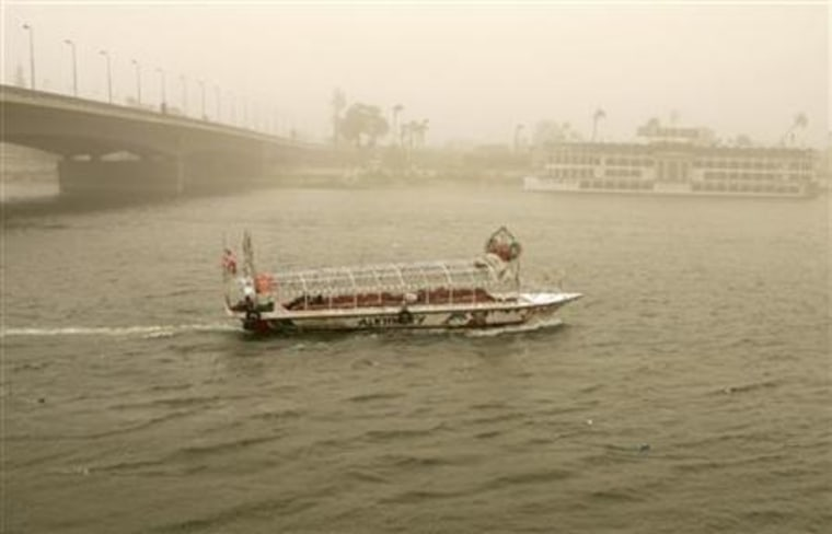 A boat cruises on the Nile River during a massive sandstorm in Cairo