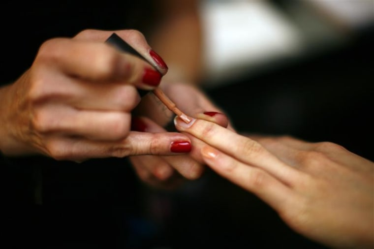 A model has her nails painted backstage before the Jenni Kayne Fall/Winter 2011 collection show during New York Fashion Week