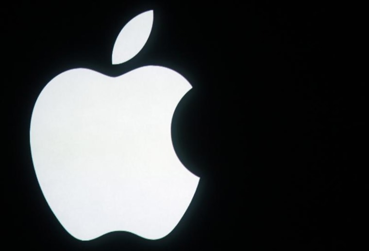 The Apple logo is displayed onstage before a product unveiling event at Apple headquarters in Cupertino