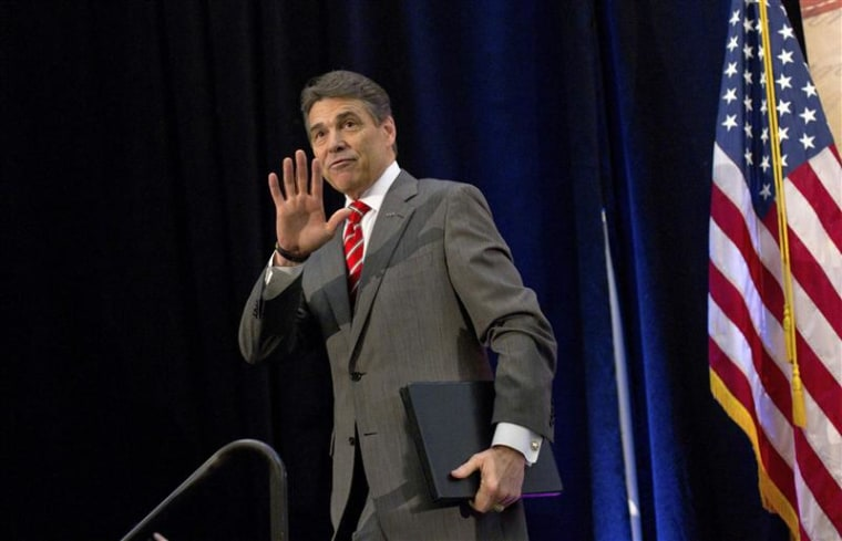 Republican presidential candidate Texas Governor Rick Perry waves after speaking during the Faith and Freedom Prayer Breakfast in Myrtle Beach