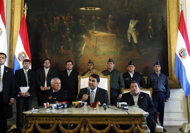 Newly appointed Paraguayan President Federico Franco speaks as he is flanked by Senator Miguel Saguier and Congressman Salustiano Salinas during a news conference at the Presidential Palace