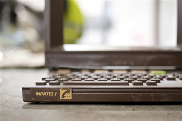 The plastic shell of a French Minitel terminal is broken down for recycling in Portet-Sur-Garonne