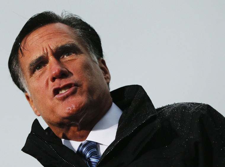 Republican presidential nominee Romney speaks during campaign rally in a downpour in Newport News