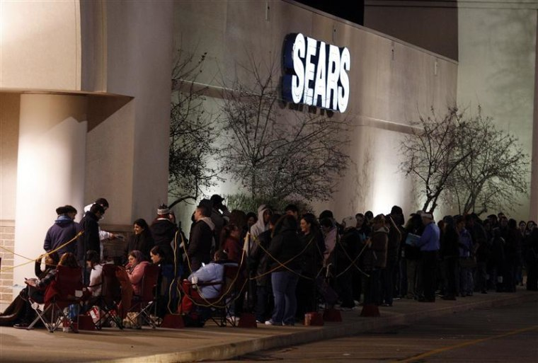 People wait outside a Sears store on the Thanksgiving Day holiday in Manchester