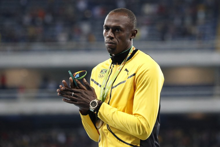 Usain Bolt with his Gold medal on the podium of the 100m men in Olympic Stadium, Rio de Janeiro, Brazil, on Aug. 15, 2016.