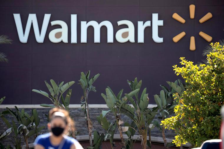A shopper leaves a Walmart Superstore in Rosemead, Calif., on June 11, 2020.