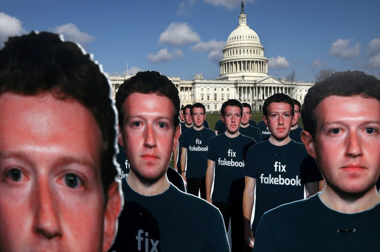 Image: Dozens of cardboard cut-outs of Facebook CEO Mark Zuckerberg sit outside of the U.S. Capitol Building as part of an Avaaz.org protest in Washington