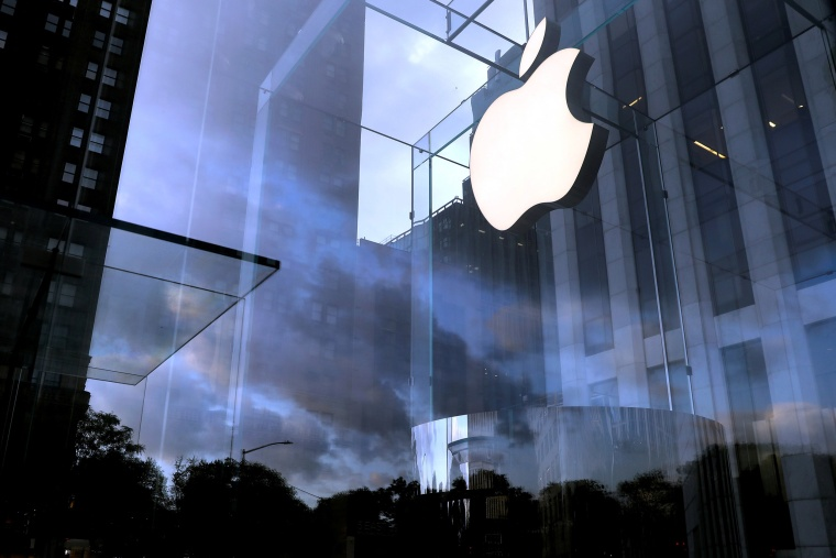 Image: The Apple Inc. logo is seen hanging at the entrance to the Apple store on 5th Avenue in Manhattan, New York.