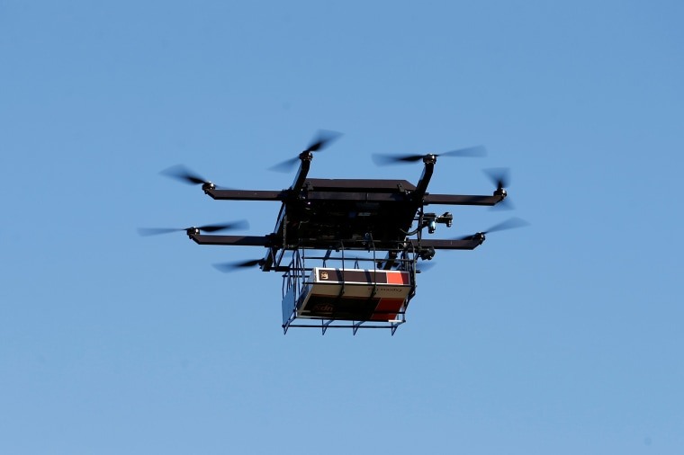 Image: A drone demonstrates delivery capabilities from the top of a UPS truck during testing in Lithia, Fla
