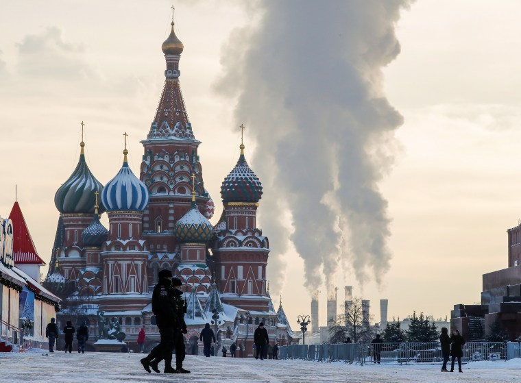 Image: Police officers walk across Red Square on a cold day in Moscow