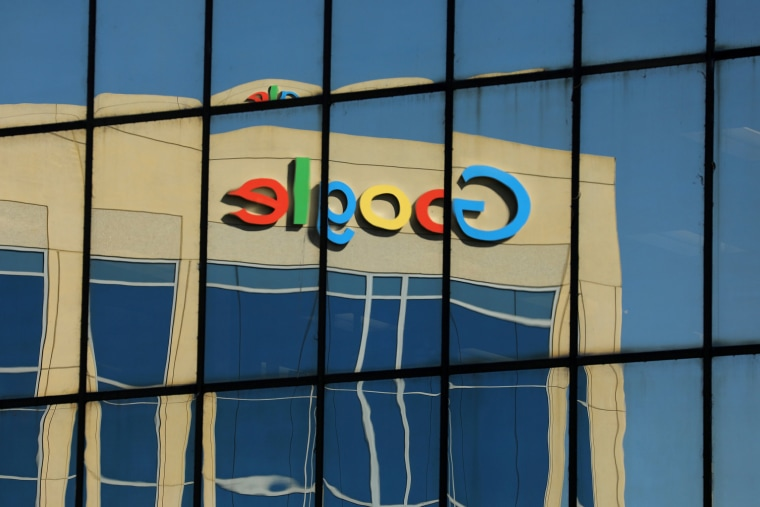 The Google logo is reflected on an office building in Irvine, Calif.