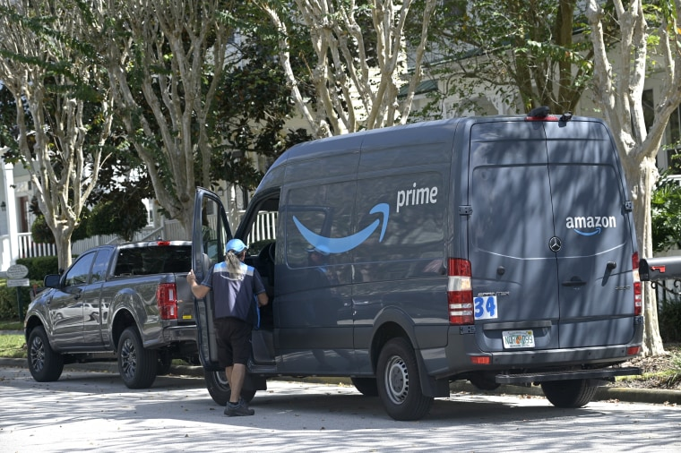 An Amazon Prime driver makes a delivery to a home, on Oct. 9, 2020, in Celebration, Fla.