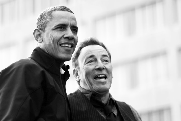 Image: Barack Obama and Bruce Springsteen during an election campaign rally in Madison