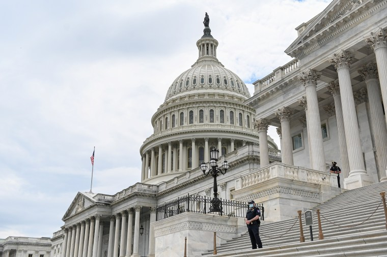 Image: Police officers guard the Capitol Building on May 14, 2020.